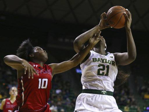 Saint Francis guard Leah Morrow, left, fouls Baylor center Kalani Brown during the first half of an NCAA college basketball game Thursday, Nov. 8, 2018, in Waco, Texas. Baylor won 116-58.