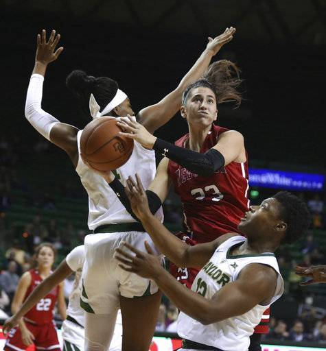 Saint Francis guard Jessica Kovatch, center, looks for a shot as Baylor guard Moon Ursin, right, and forward NaLyssa Smith, left, defend during the first half of an NCAA college basketball game Thursday, Nov. 8, 2018, in Waco, Texas.