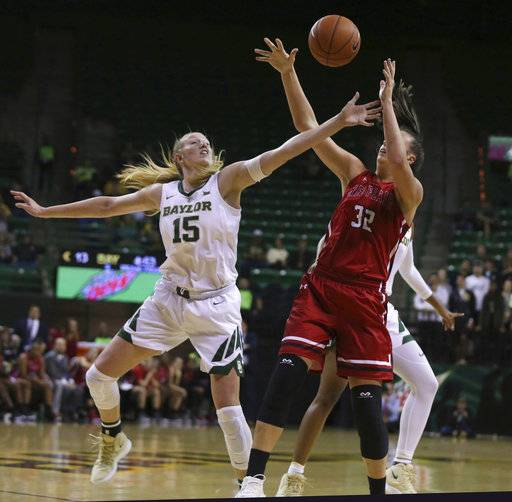 Baylor forward Lauren Cox, left, blocks the shot of Saint Francis center Courtney Zezza during the first half of an NCAA college basketball game Thursday, Nov. 8, 2018, in Waco, Texas.