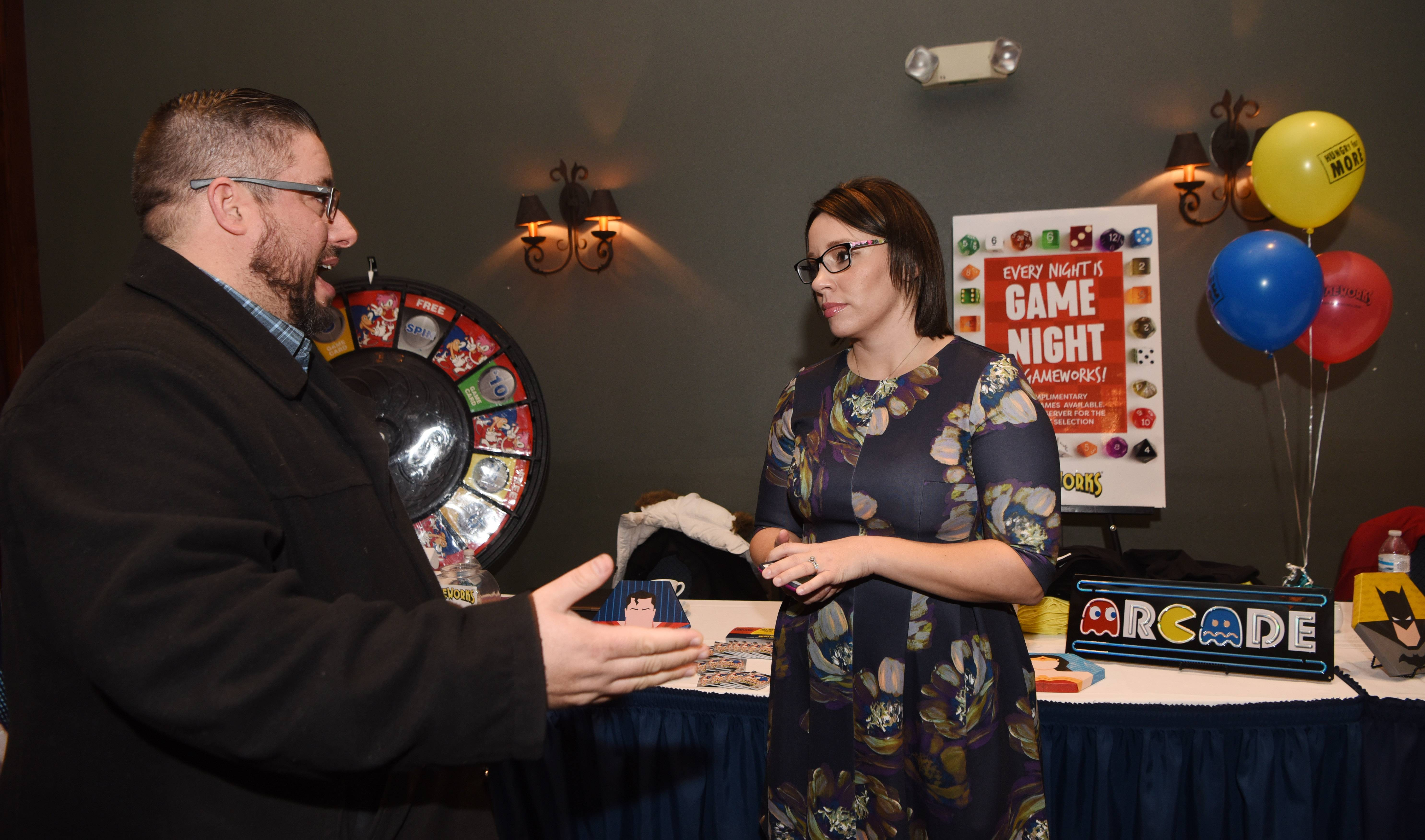 Joe Lewnard/jlewnard@dailyherald.comJoe Regilio of Bowlero talks with Mary Lindhola of Gameworks during the Northwest Suburban Hospitality Expo, hosted by the Daily Herald Business Ledger at the Stonegate Conference and Banquet Centre in Hoffman Estates Thursday.