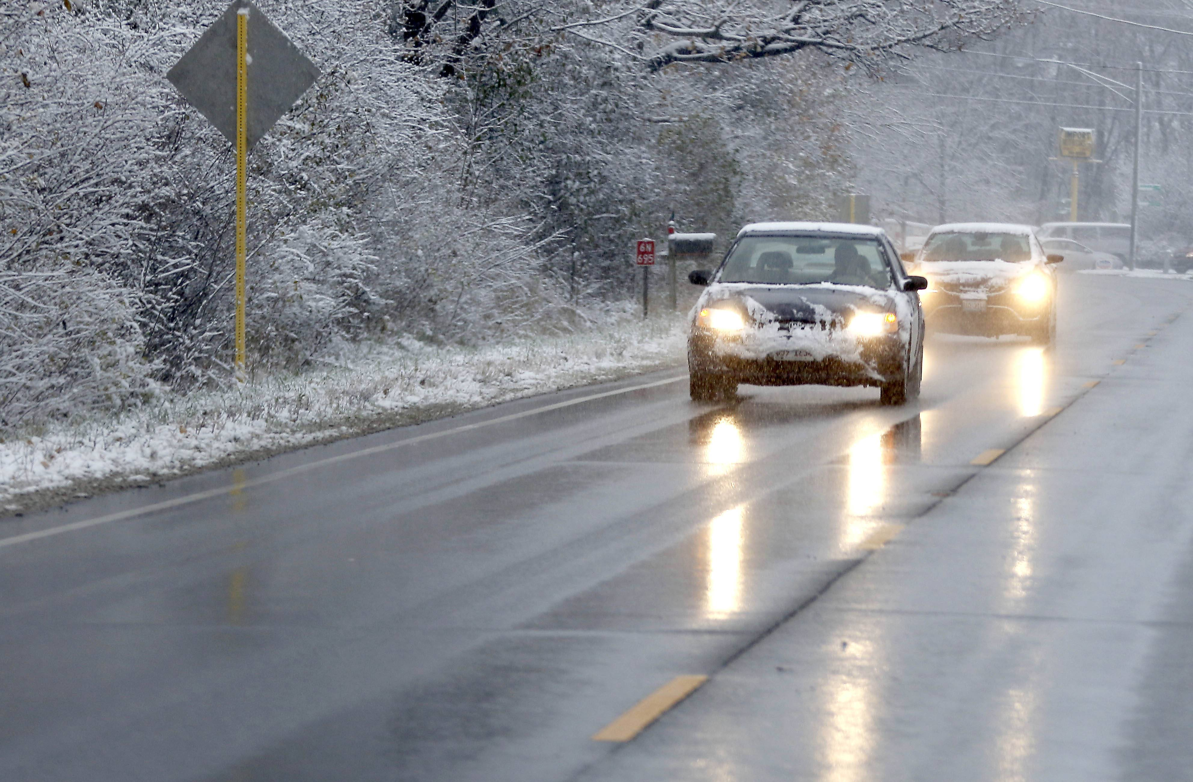 Cars travel northbound on Route 25 in St. Charles as snow makes for a messy commute on Friday.