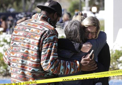 Mourners embrace outside of the Thousand Oaks Teen Center, where relatives and friends gathered in the aftermath of a mass shooting, Thursday, Nov. 8, 2018, in Thousand Oaks, Calif. Multiple people were shot and killed late Wednesday by a gunman who opened fire at the Borderline Bar & Grill, which was holding a weekly country music dance night for college students.