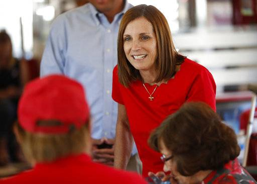 Arizona Republican senatorial candidate Martha McSally, speaks with voters, Tuesday, Nov. 6, 2018, at Chase's diner in Chandler, Ariz. McSally and Democratic challenger Kirsten Sinema are seeking the senate seat being vacated by Jeff Flake, R-Ariz., who is retiring in January.