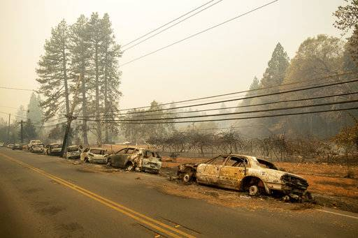 Abandoned vehicles line Skyway after a wildfire burned through Paradise, Calif., on Friday, Nov. 9, 2018.