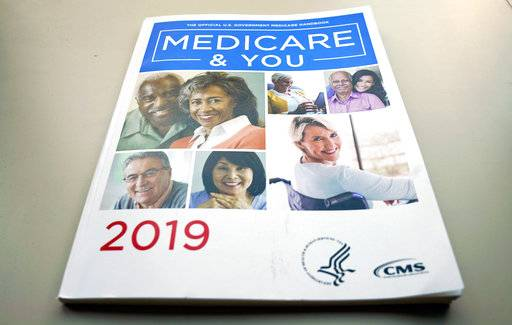 The U.S. Medicare Handbook is photographed Thursday, Nov. 8, 2018, in Washington. Seniors in many states will be able to get additional services like help with chores, safety devices and respite for caregivers next year through private 'Medicare Advantage' insurance plans. It's a sign of potentially big changes for Medicare.