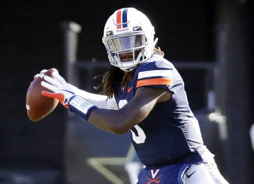 FILE - In this Sept. 15, 2018, file photo, Virginia quarterback Bryce Perkins throws a pass against Ohio in the first half of an NCAA college football game in Nashville, Tenn. Virginia faces Liberty on Saturday.