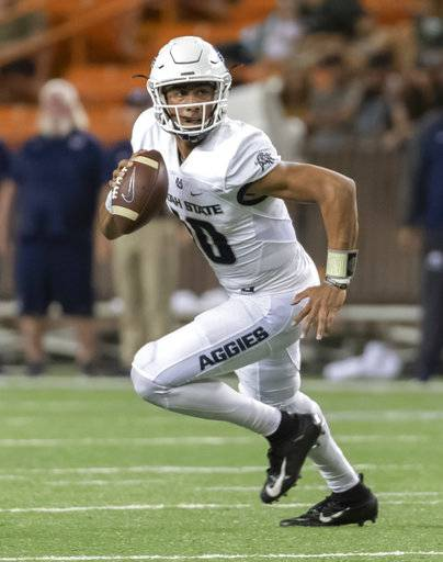 Utah State quarterback Jordan Love (10) rolls out looking for an open receiver to pass to in the first half of an NCAA college football game against Hawaii, Saturday, Nov. 3, 2018, in Honolulu.