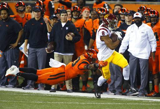 Southern California's Amon-Ra St. Brown (8) pulls away from Oregon State's Jalen Moore, left, after making a reception in the first half of an NCAA college football game in Corvallis, Ore., Saturday, Nov. 3, 2018.