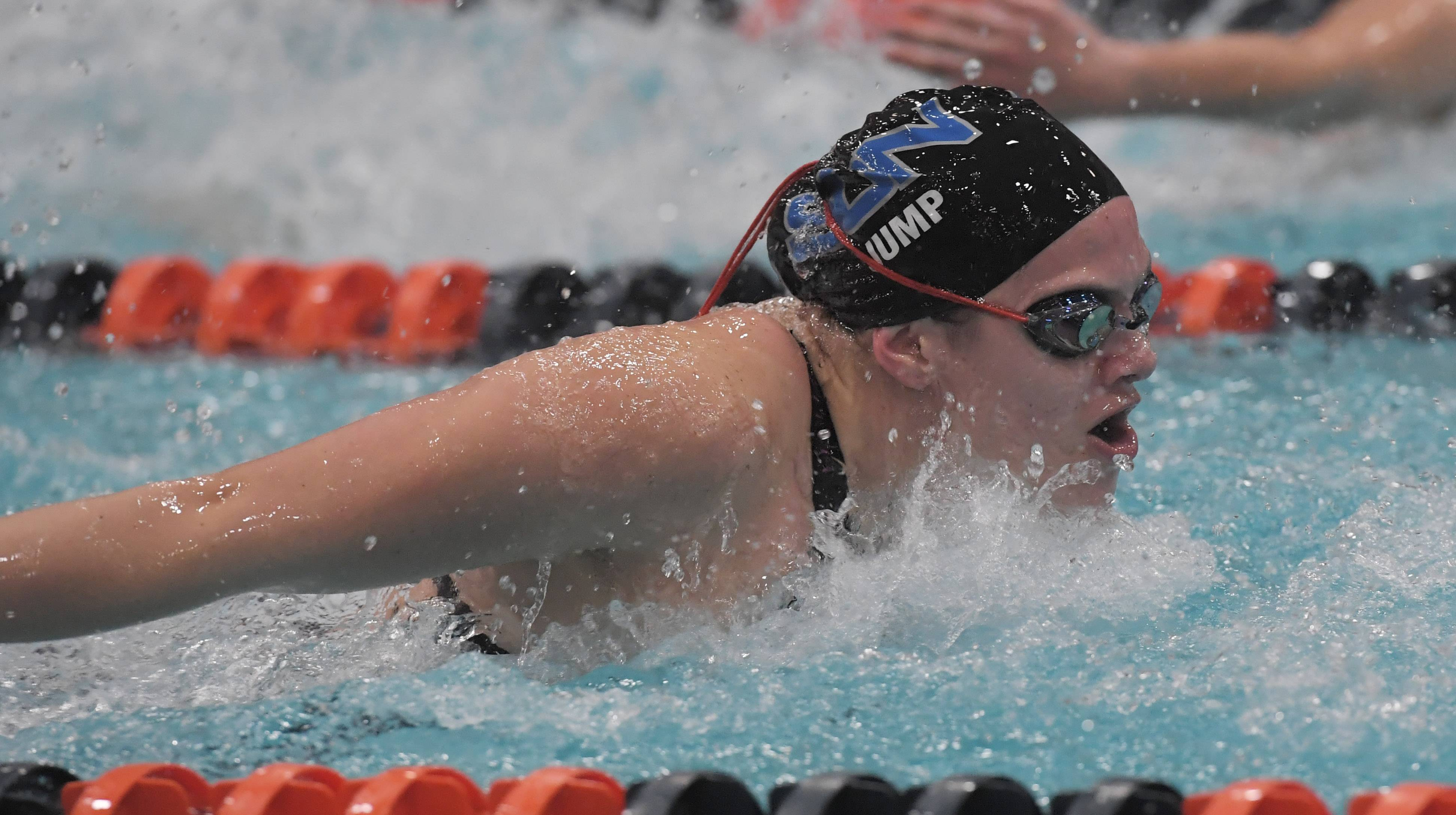St. Charles North's Mallory Jump swims butterfly in the 200-yard medley relay during the girls state swimming finals at Evanston High School Saturday. The North Stars won the event with a time of 1:41.95.