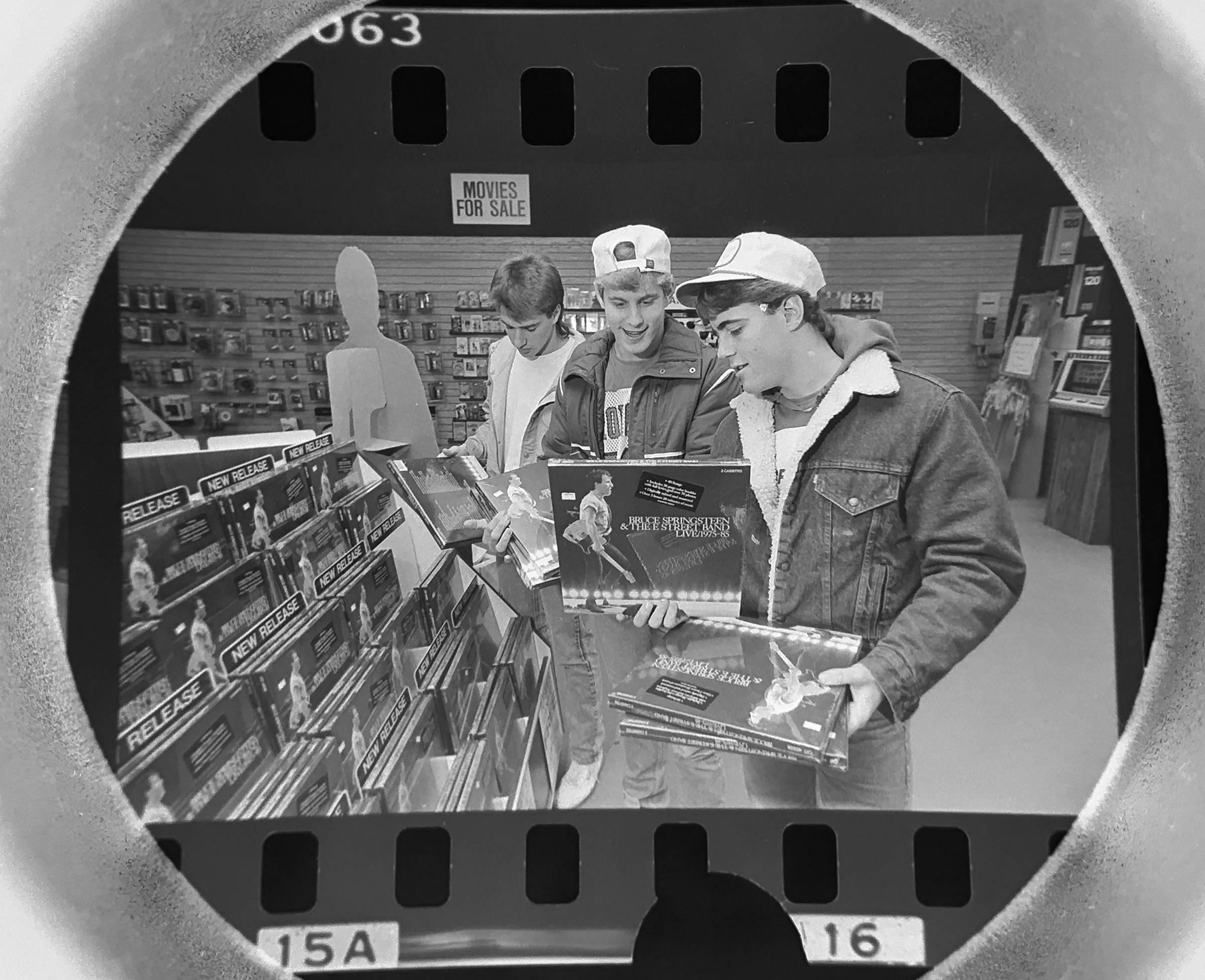 The Daily Herald archive, Assignment # 84,990, Rich Chapman photo: Mike Janke and Jim Goodwin of Barrington check out the new Bruce Springsteen album at Flip Side Records in Hoffman Estates in November of 1986.