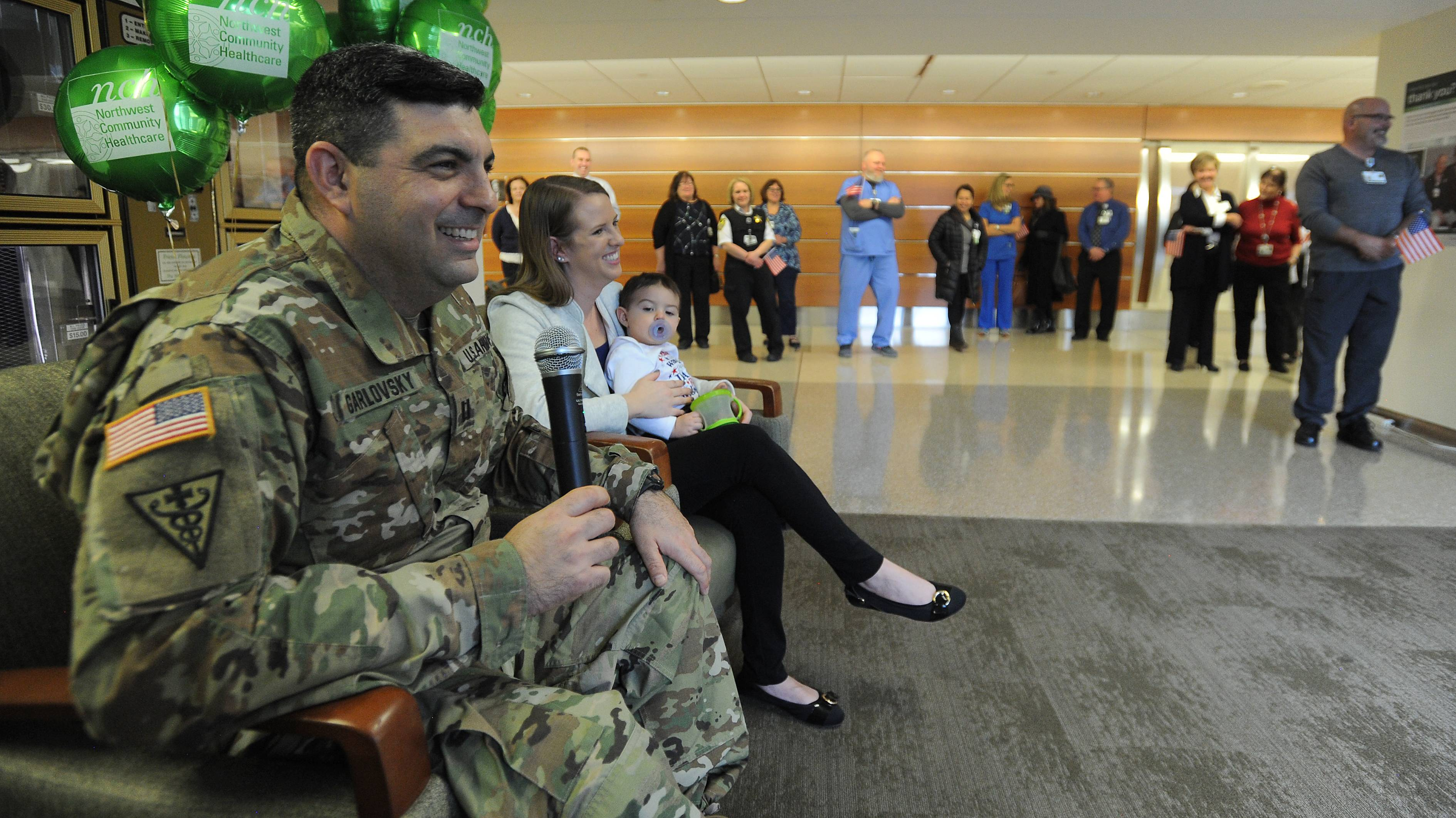 Dr. Jonathan Garlovsky talks to fellow Northwest Community Hospital employees Monday in Arlington Heights about his three-month deployment in Kuwait with the U.S. Army Reserve.