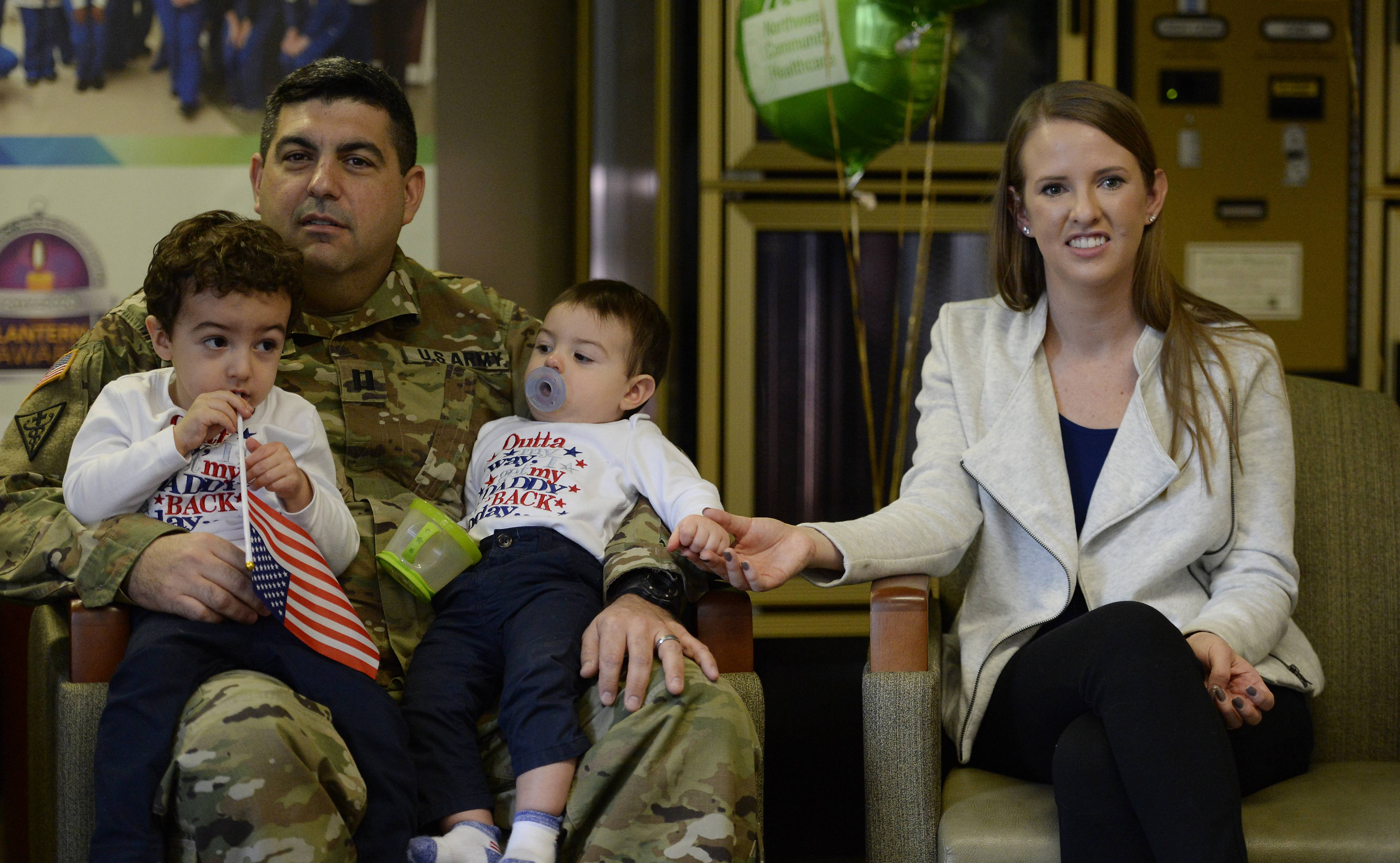 Dr. Jonathan Garlovsky, with his wife, Trisha, and sons Mason, 2, and Nate, 1, returned to Northwest Community Hospital in Arlington Heights on Monday. He spent three months with the U.S. Army Reserve in Kuwait.