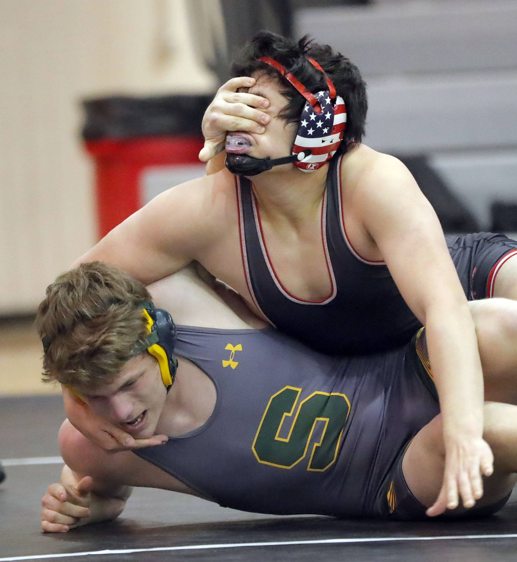 Stevenson's Michael Phelps opposes Barrington's Jack Hartman, top, as they wrestle at 195 pounds during a triple-dual meet Saturday at Grant High School in Fox Lake.