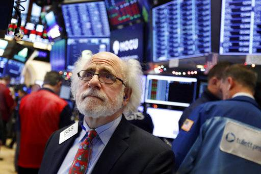 Trader Peter Tuchman works on the floor of the New York Stock Exchange, Thursday, Dec. 6, 2018. U.S. stocks tumbled in early trading Thursday following a sell-off in overseas markets.