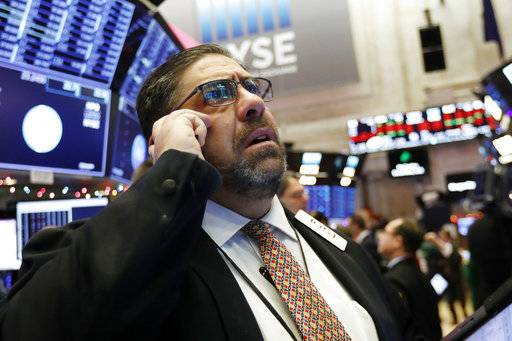 Trader Robert Oswald works on the floor of the New York Stock Exchange, Thursday, Dec. 6, 2018. U.S. stocks tumbled in early trading Thursday following a sell-off in overseas markets.