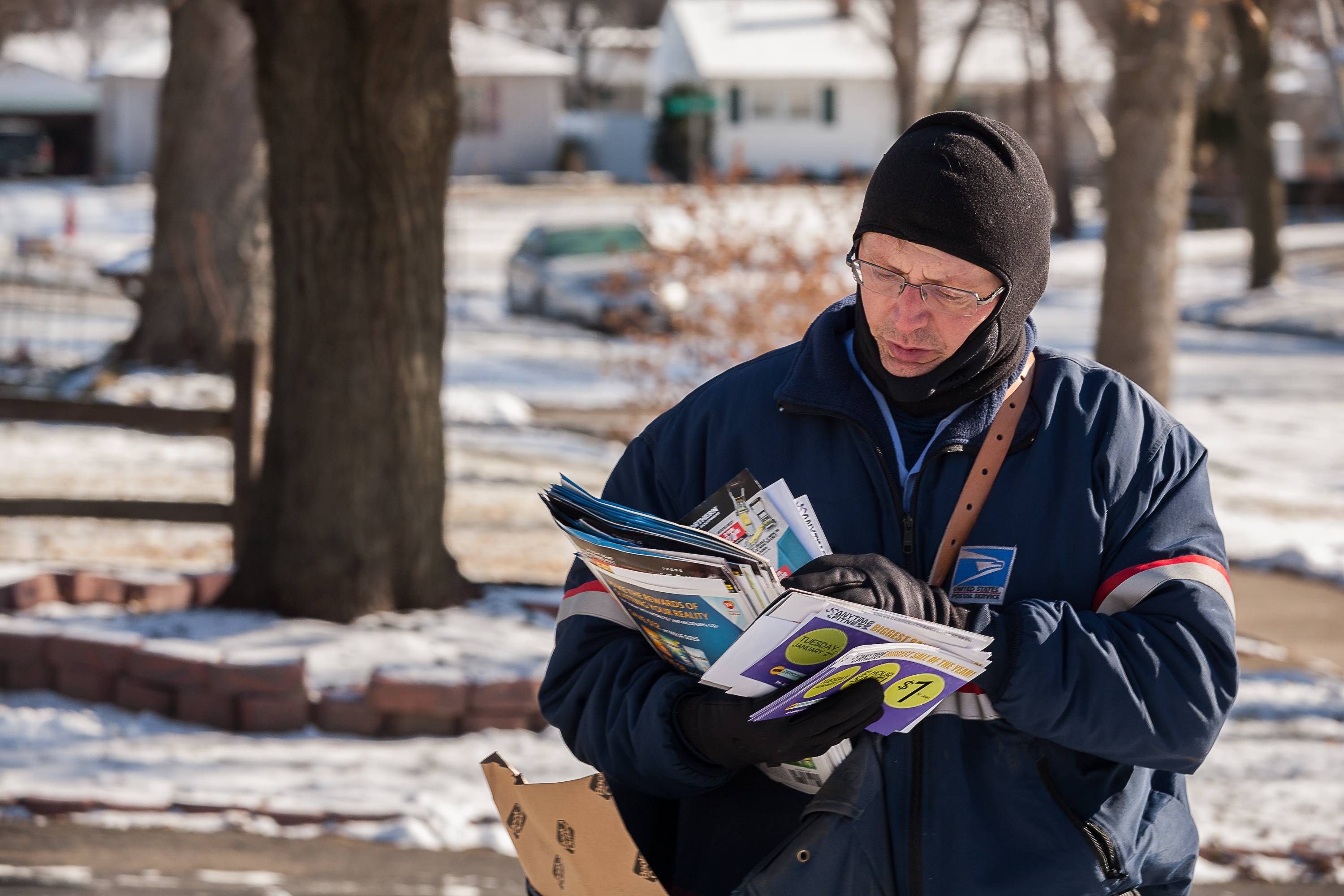 U.S. Postal Service letter carrier David Goulding delivers the mail during the holiday season.