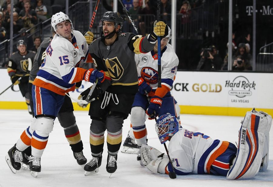 Vegas Golden Knights center Brandon Pirri, center, celebrates after scoring against New York Islanders goaltender Thomas Greiss during the second period of an NHL hockey game Thursday, Dec. 20, 2018, in Las Vegas.