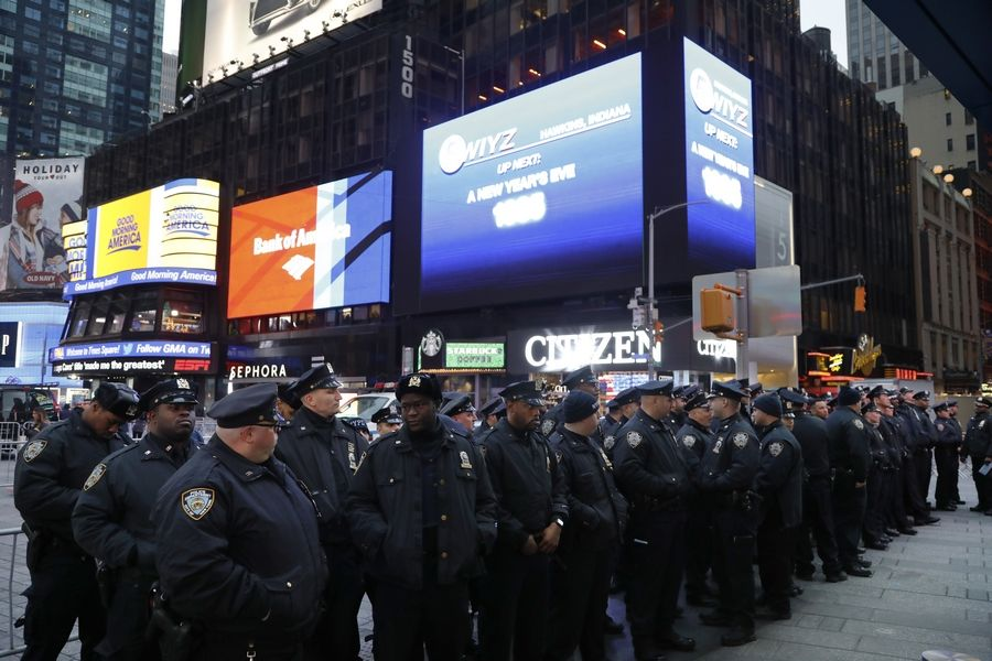 Police assemble in New York's Times Square Monday before beginning to patrol.
