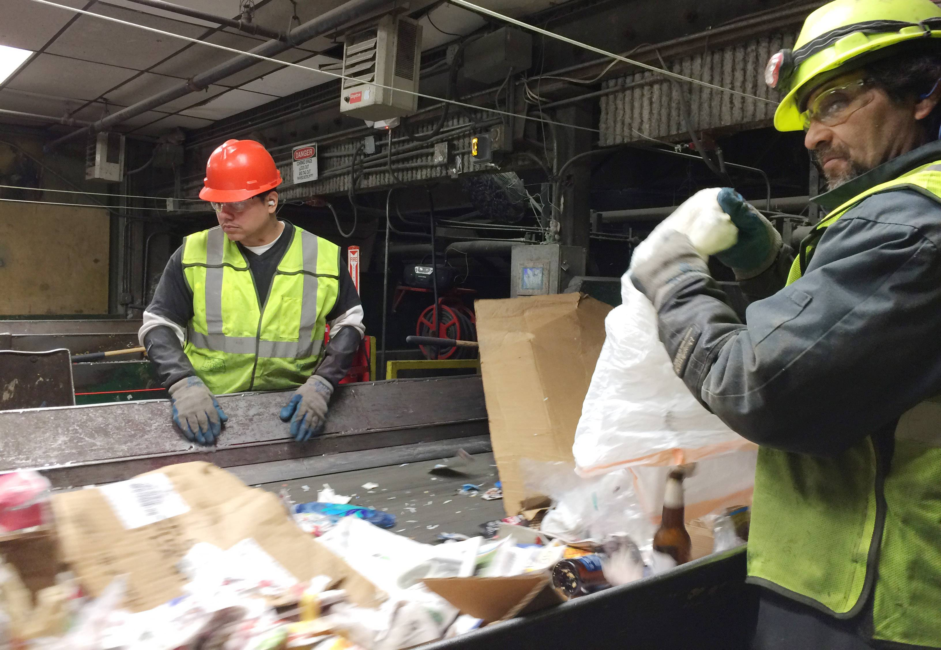 Workers remove plastic and other contaminants from incoming recyclables at Waste Management's processing facility in Grayslake. Waste industry experts say the push is on for cleaner recyclables.