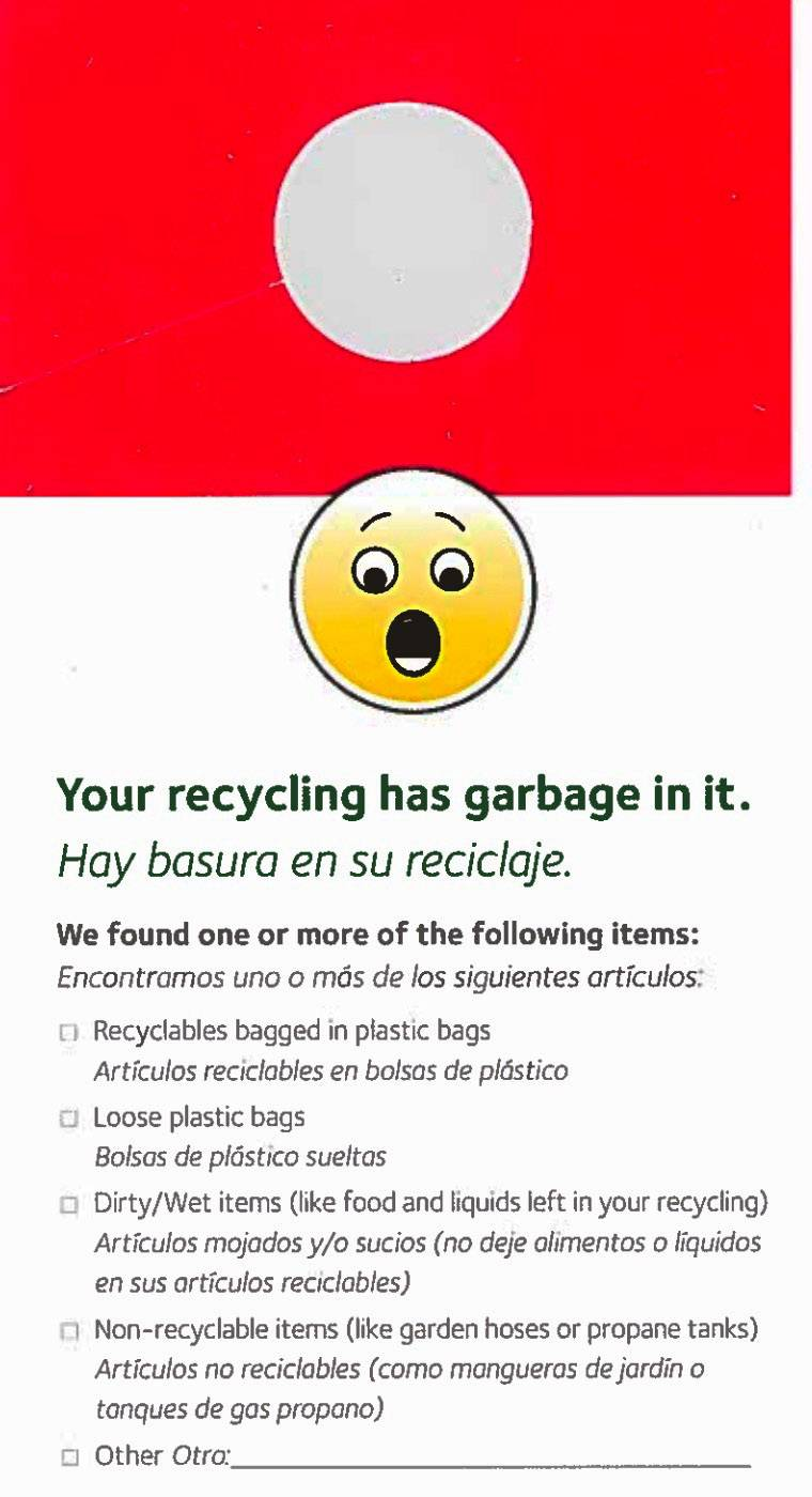 Recycling notices distributed in Round Lake Beach by Waste Management.