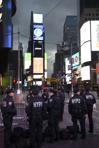 Police assemble in New York's Times Square before patrolling on New Year's Eve, Monday, Dec. 31, 2018.