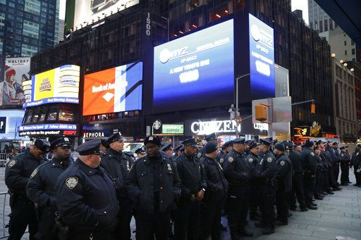 Police assemble in New York's Times Square before beginning to patrol, Monday, Dec. 31, 2018, in New York.