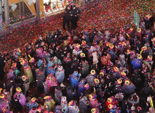 Confetti covers the crowd during the New Year's celebration in Times Square as seen from the Marriott Marquis in New York, early Tuesday, Jan. 1, 2019.
