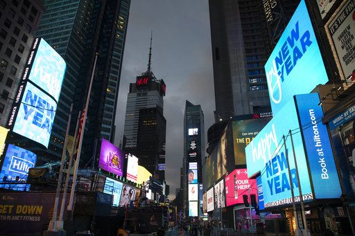 Billboards welcome in the new year in New York's Times Square, Monday, Dec. 31, 2018.