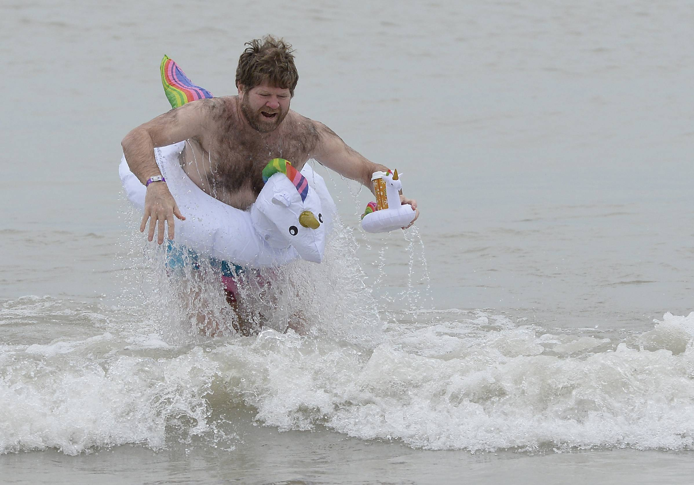 Libertyville resident Robert Zanze was among more than 100 hardy souls who braved the cold waters of Lake Michigan on Tuesday for the 20th annual Polar Bear Plunge to raise funds for Waukegan Special Recreation Services helping individuals with disabilities.