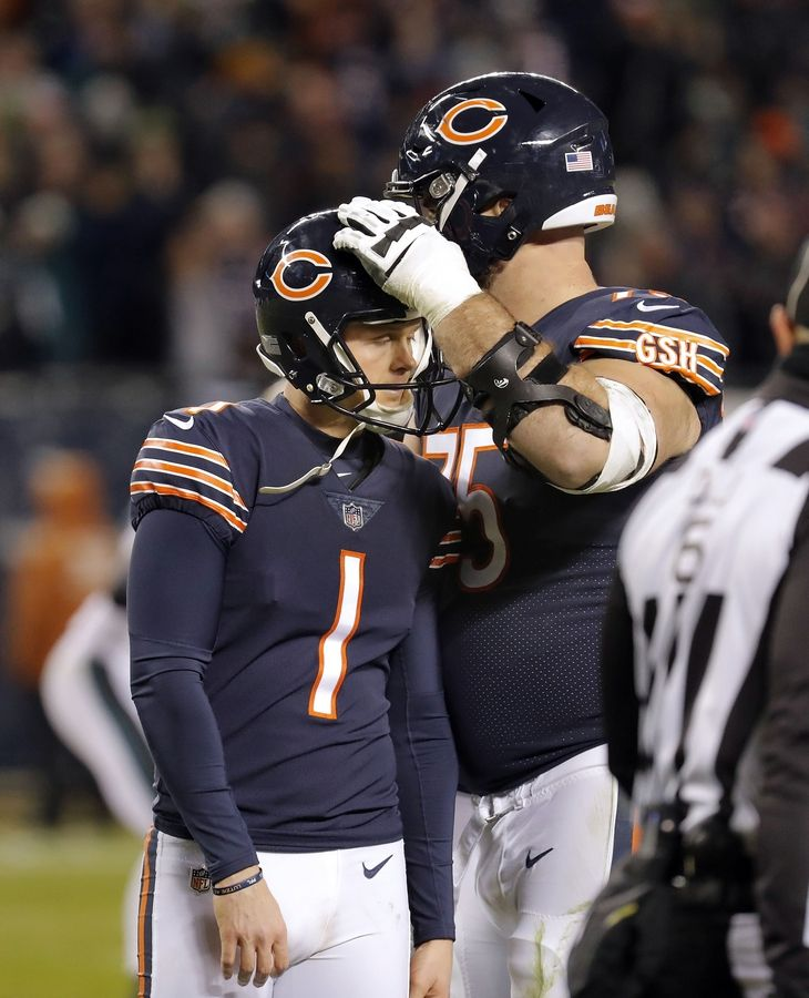 Chicago Bears offensive guard Kyle Long consoles kicker Cody Parkey Sunday after Parkey missed a field goal at the end of the game.