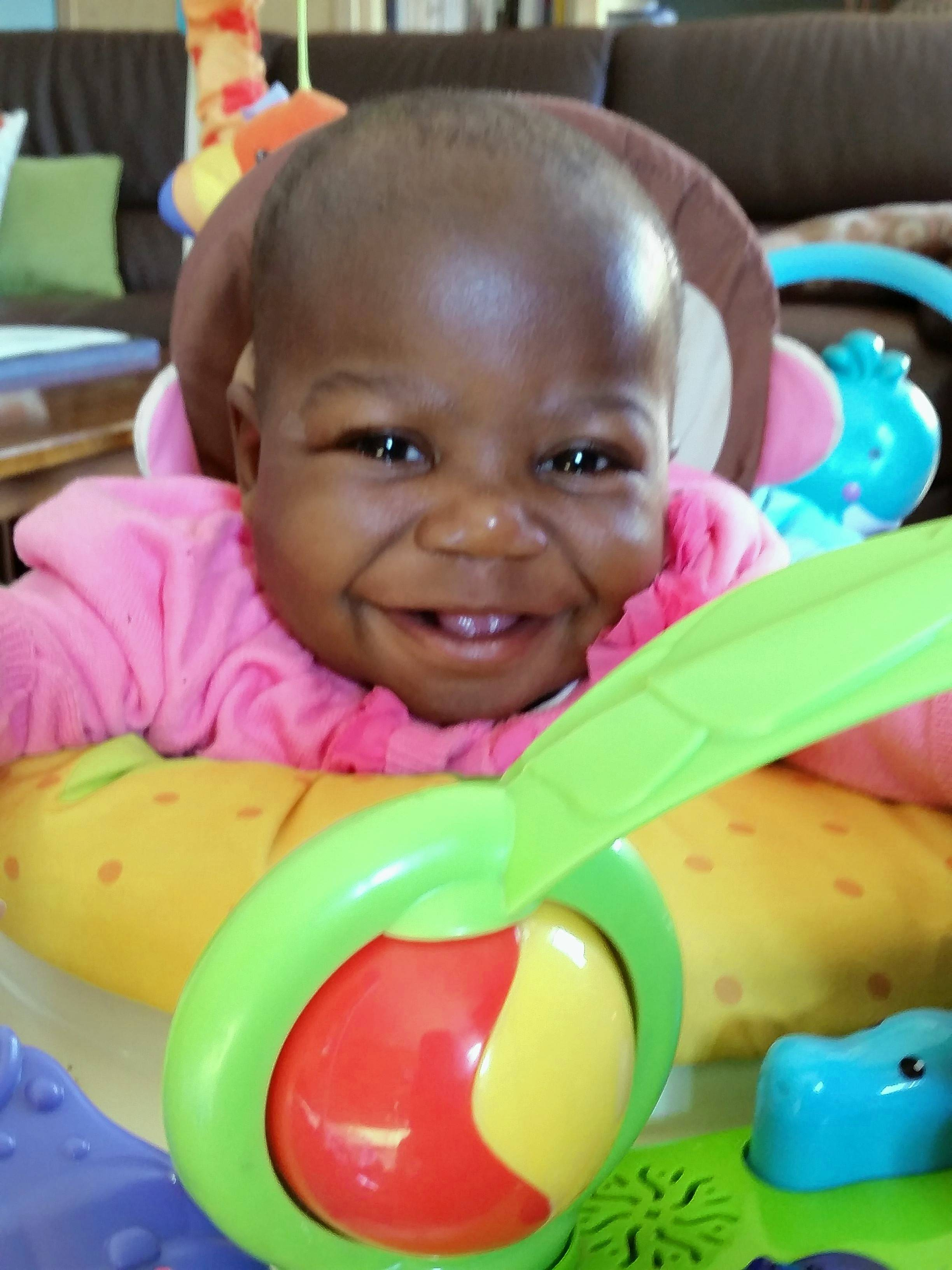 After life-changing surgery in 2017 at Advocate Children's Hospital in Park Ridge, Dominique was all smiles and expected to live a normal life. Malaria is believed to be the cause of her death last year.