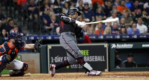 FILE - In this Sept. 14, 2018, file photo, Arizona Diamondbacks' Jon Jay, right, hits a triple to score Nick Ahmed as Houston Astros catcher Brian McCann looks on at left, during the eighth inning of a baseball game, in Houston. The Chicago White Sox and free-agent outfielder Jon Jay have finalized a $4 million, one-year contract. The 33-year-old Jay played for Kansas City and Arizona last season, batting .268 with three homers and 40 RBIs in 143 games.
