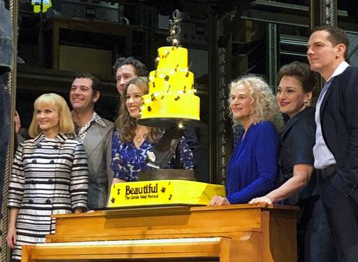 "In this Saturday, Jan. 12, 2019, photo Carole King, third from right, poses for photos with the cast of ""Beautiful: The Carole King Musical� at the Stephen Sondheim Theatre after a performance in New York. King appeared Saturday night, sitting at a baby grand piano and showing all the love in her heart as she sang ""Beautiful,"" the final song to celebrate the show's fifth anniversary on Broadway."