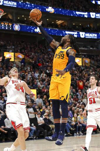 Utah Jazz forward Jae Crowder (99) shoots next to Chicago Bulls' Lauri Markkanen, left, during the second quarter of an NBA basketball game Saturday, Jan. 12, 2019, in Salt Lake City.