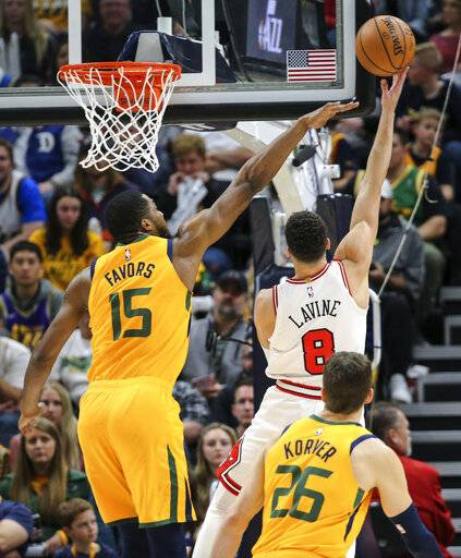 Utah Jazz forward Derrick Favors (15) tries to block the shot of Chicago Bulls guard Zach LaVine (8) during the second quarter of an NBA basketball game Saturday, Jan. 12, 2019, in Salt Lake City.