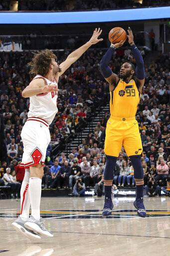 Utah Jazz forward Derrick Favors (15) shoots the ball over Chicago Bulls center Robin Lopez during the second quarter of an NBA basketball game Saturday, Jan. 12, 2019, in Salt Lake City.