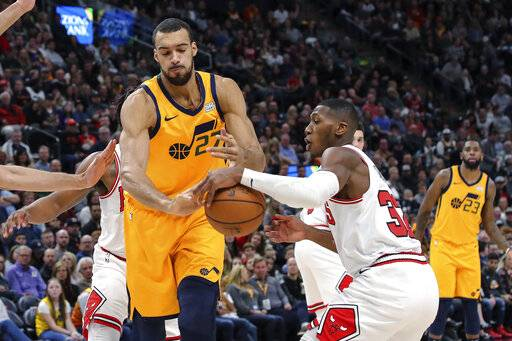 Chicago Bulls guard Kris Dunn (32) steals the ball away from Utah Jazz center Rudy Gobert (27) during the second quarter of an NBA basketball game Saturday, Jan. 12, 2019, in Salt Lake City.