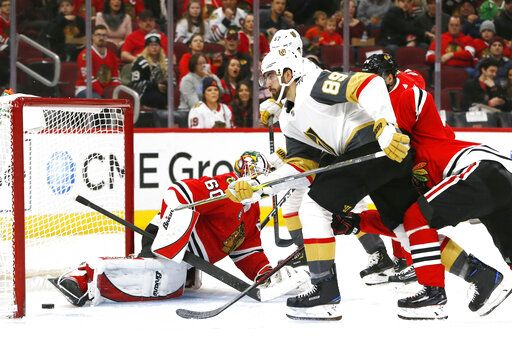 Vegas Golden Knights right wing Alex Tuch (89) scores a goal past Chicago Blackhawks goaltender Collin Delia (60) during the second period of an NHL hockey game Saturday, Jan. 12, 2019, in Chicago.