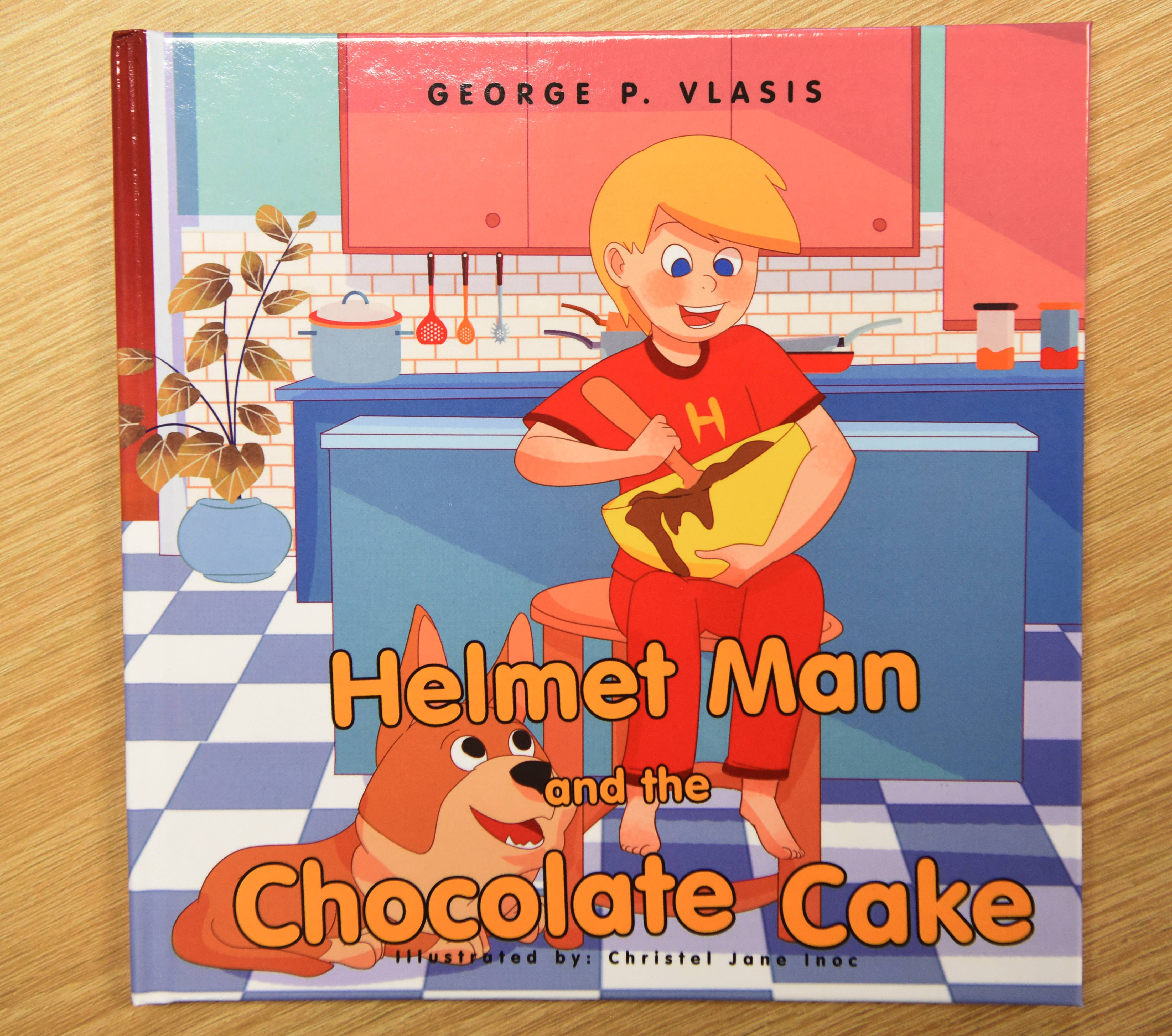 """Helmet Man and the Chocolate Cake"" is a children's book by George Vlasis, a kindergarten teacher at Hough Street Elementary School in Barrington."