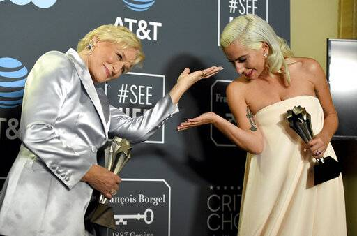 "Glenn Close, left, and Lady Gaga, winners in a tie for the best actress award, pose in the press room at the 24th annual Critics' Choice Awards on Sunday, Jan. 13, at the Barker Hangar in Santa Monica, Calif. Close won for her role in ""The Wife"" and Lady Gaga won for her role in ""A Star Is Born."""