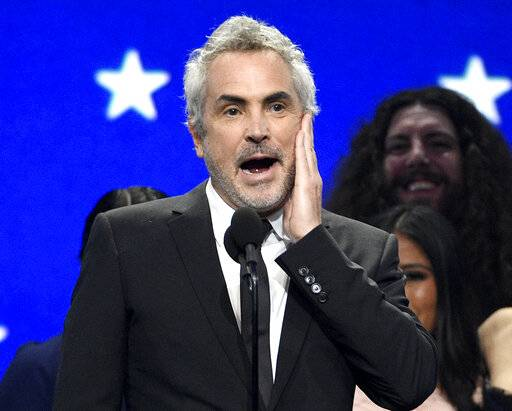 "Alfonso Cuaron reacts as he accepts the award for best picture for ""Roma"" at the 24th annual Critics' Choice Awards on Sunday, Jan. 13, 2019, at the Barker Hangar in Santa Monica, Calif. (Photo by Chris Pizzello/Invision/AP)"
