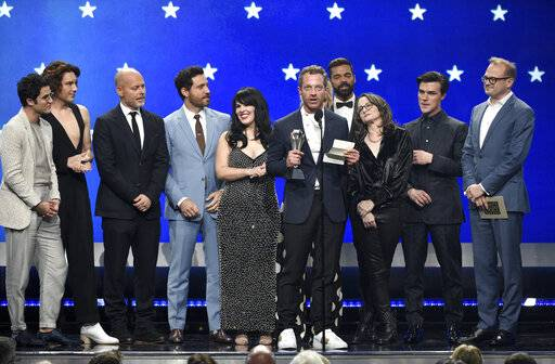 "Tom Rob Smith and the cast and crew of ""The Assassination of Gianni Versace: American Crime Story"" accept the award for best limited series at the 24th annual Critics' Choice Awards on Sunday, Jan. 13, 2019, at the Barker Hangar in Santa Monica, Calif. (Photo by Chris Pizzello/Invision/AP)"
