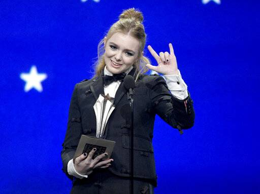 "Elsie Fisher accepts the award for best young actor/actress for ""Eighth Grade"" at the 24th annual Critics' Choice Awards on Sunday, Jan. 13, 2019, at the Barker Hangar in Santa Monica, Calif. (Photo by Chris Pizzello/Invision/AP)"