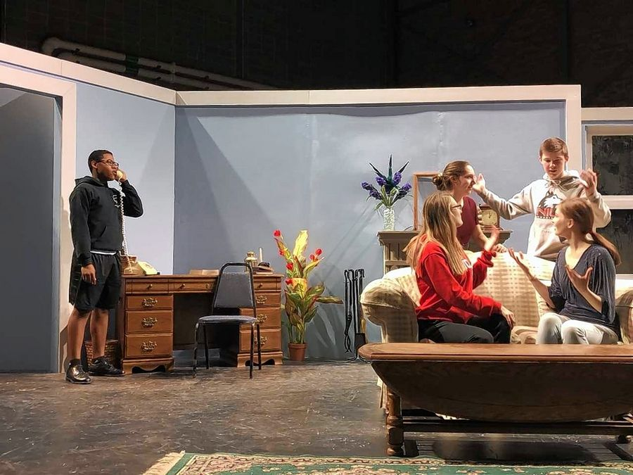 "From left, sophomore Isaiah Watson (Inspector Benjamin Braddock), freshman Aubrie Christiansen (Chloe Custardine), freshman David Simpson (Algernon Wickenham), sophomore Emma Hinkle (Lady Monica Wickenham), and freshman Kate Robertson (Bibi Cavendish) rehearse a scene from ""While the Lights Were Out."""