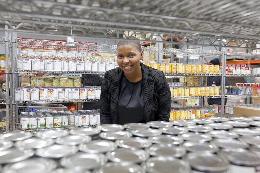 Five Elgin-area pantries are inviting federal workers, contractors and subcontractors who aren't getting paid during the partial government shutdown to use their services. Pictured here Wednesday is Shelia Jackson, executive director of Food for Greater Elgin.