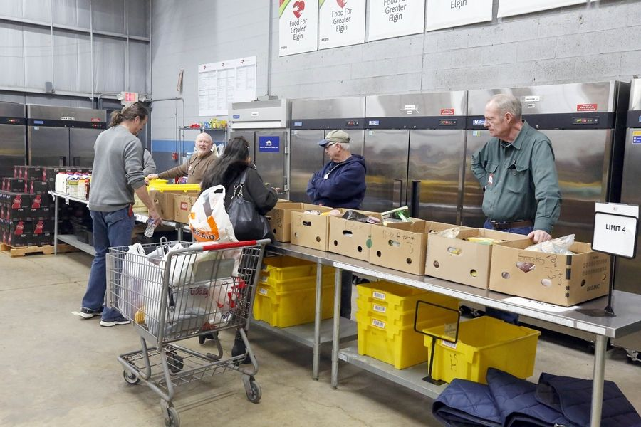 Volunteers lined up to help pass out food and other items Wednesday at Food for Greater Elgin, which is among five area food pantries offering their services to workers affected by the partial government shutdown.