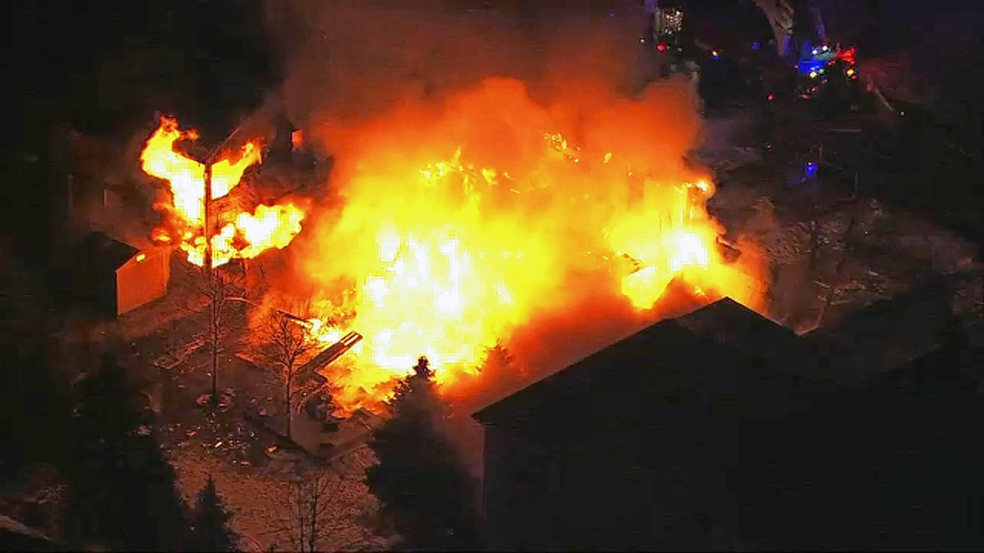 Flames engulf a single-family home on Melanie Lane in Northbrook Wednesday morning. At least three homes were damaged in the blaze.