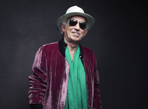 "FILE - In this Nov. 14, 2016 file photo, Keith Richards of the Rolling Stones poses for a portrait in New York. Richards is celebrating the 30th anniversary of his solo debut album by reissuing it. Richards originally released ""Talk Is Cheap� in 1988 and will reissue the album on March 29. It will include six bonus tracks and will be released digitally, on CD, on vinyl and as a box set.  (Photo by Victoria Will/Invision/AP, File)"