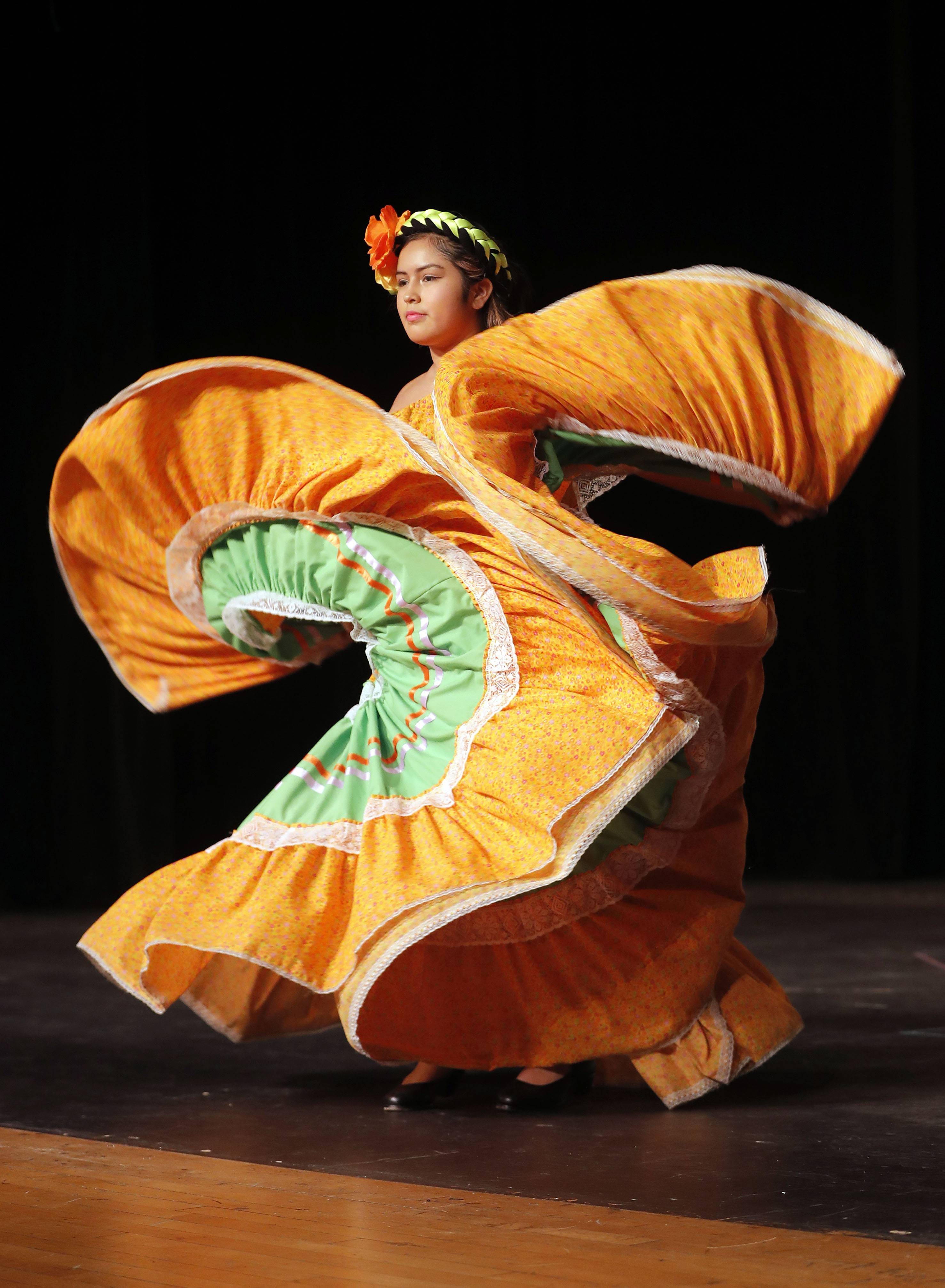 Sophomore Sofia Mendez performs a Mexican folkloric ballet Thursday at Mundelein High School's Cultural Fair.