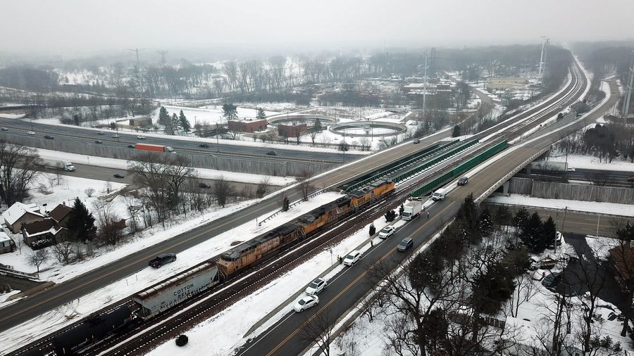 Trains backed up near Crescent Blvd. and Finley Road in Lombard after a person was struck by a freight train Thursday.